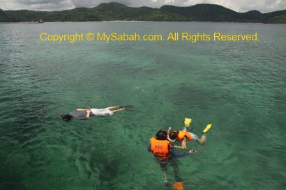 Snorkelling in Usukan Cove Lodge