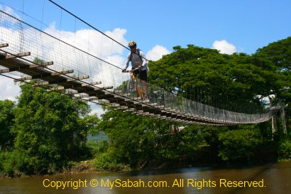 Cycling stunt on suspension bridge