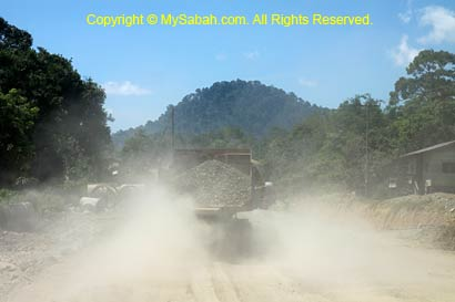 Truck on dusty gravel road