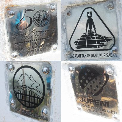 logos on Center of Sabah Monument