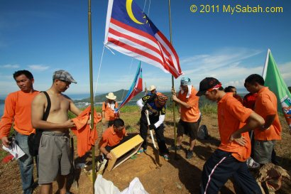 setting up flags and plaque on Gundul Hill