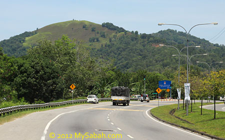 view of Gundul Hill from the road