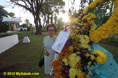 wreath by Japanese couple for World War II victims