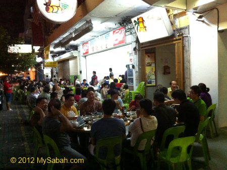 people sitting outside Yu Kee