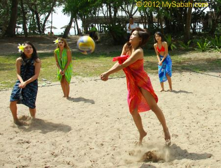 Miss Oriental contestants playing beach volleyball
