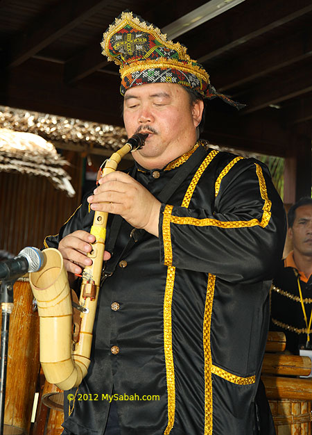 Kadazan man plays bamboo saxophone