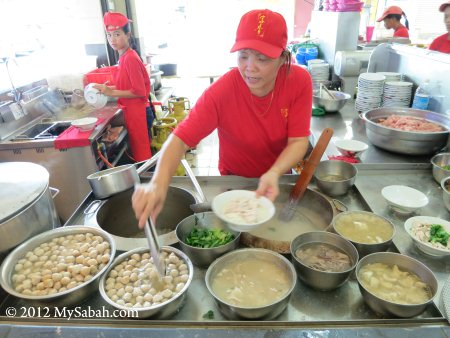 staff preparing Sang Nyuk Mee (Pork Noodle)
