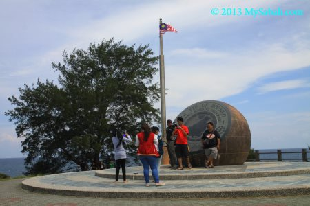 flagpole and globe monument
