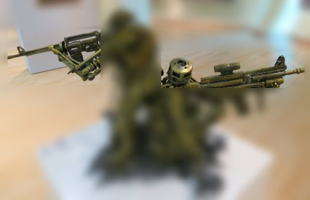 metal sculpture of armed force