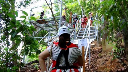 trekking to starting point of zipline