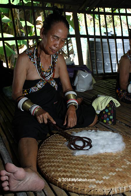 Rungus woman making cloth made from cotton