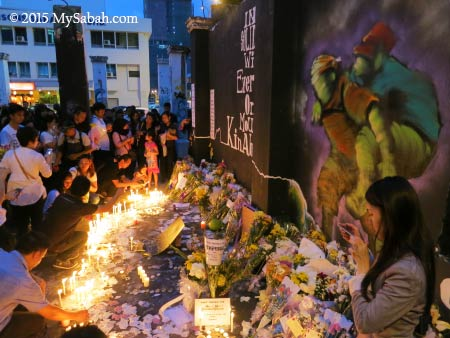 crowd gathered at makeshift memorial site for Sabah Earthquake 2015
