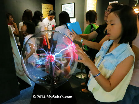 kid playing with Nebula globe