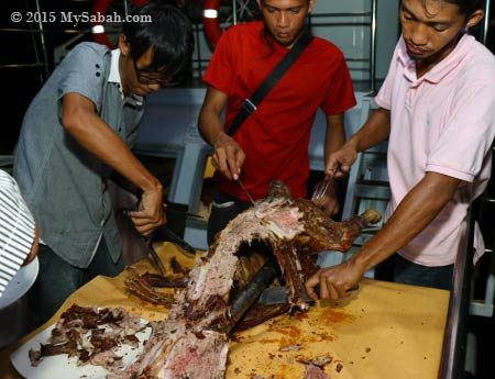 cutting barbecue lamb