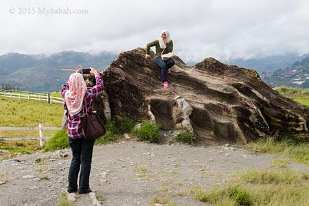 visitor taking photo on boulder