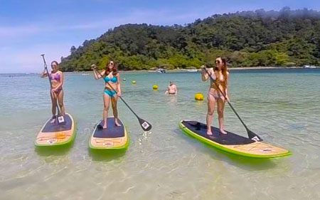 girls doing Stand Up Paddle Boarding