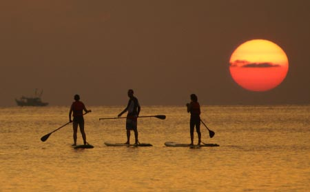 Stand-Up Paddleboarding to sunset