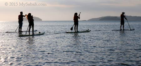 Stand-up paddle-boarding in Tanjung Aru First Beach