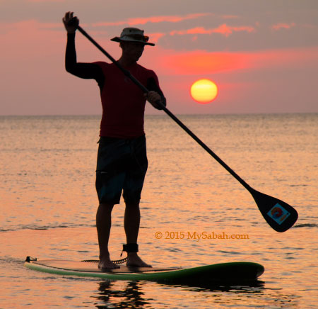 stand up paddle boarding during sunset