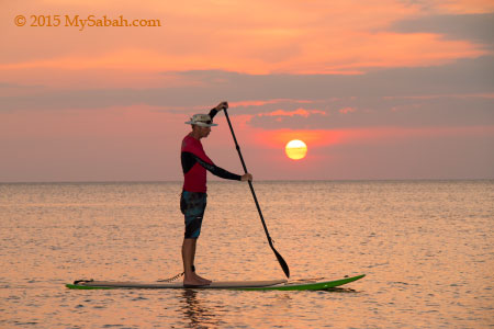 Standup paddleboarding in sunset