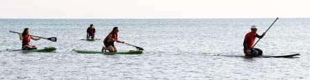 Stand-up paddle-boarding on the sea of Tanjung Aru First Beach