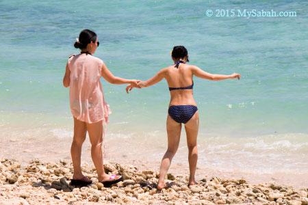 walking on coral beach
