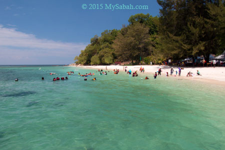 tourists at the beach of Pulau Mamutik