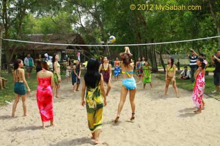 Miss Oriental contestants playing volleyball at Borneo Kelly Bays