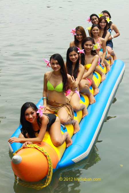 Miss Oriental contestants on banana boat of Borneo Kelly Bays