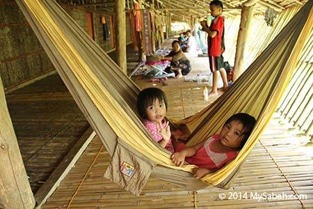 children in longhouse