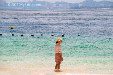 girl walking in the sea
