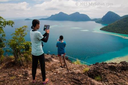 taking photo on peak of Bohey Dulang