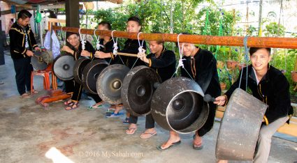 Welcoming gong by villagers
