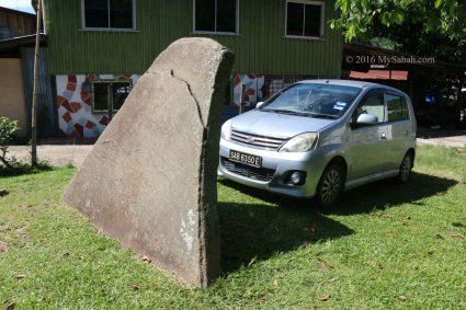 A car shields itself from sunlight with Watu Tinuridung stone