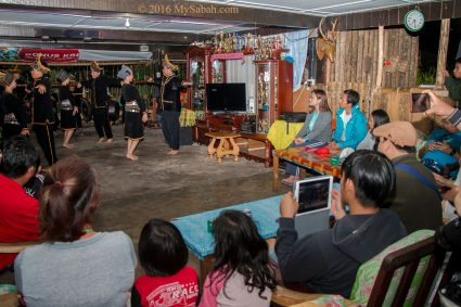 Guests enjoying the traditional dance performance