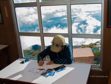 Writing postcards in Pendant Hut