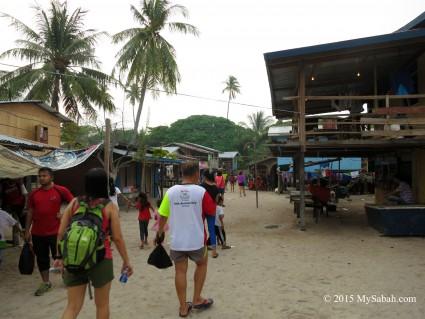 Walking in the village of Mabul Island