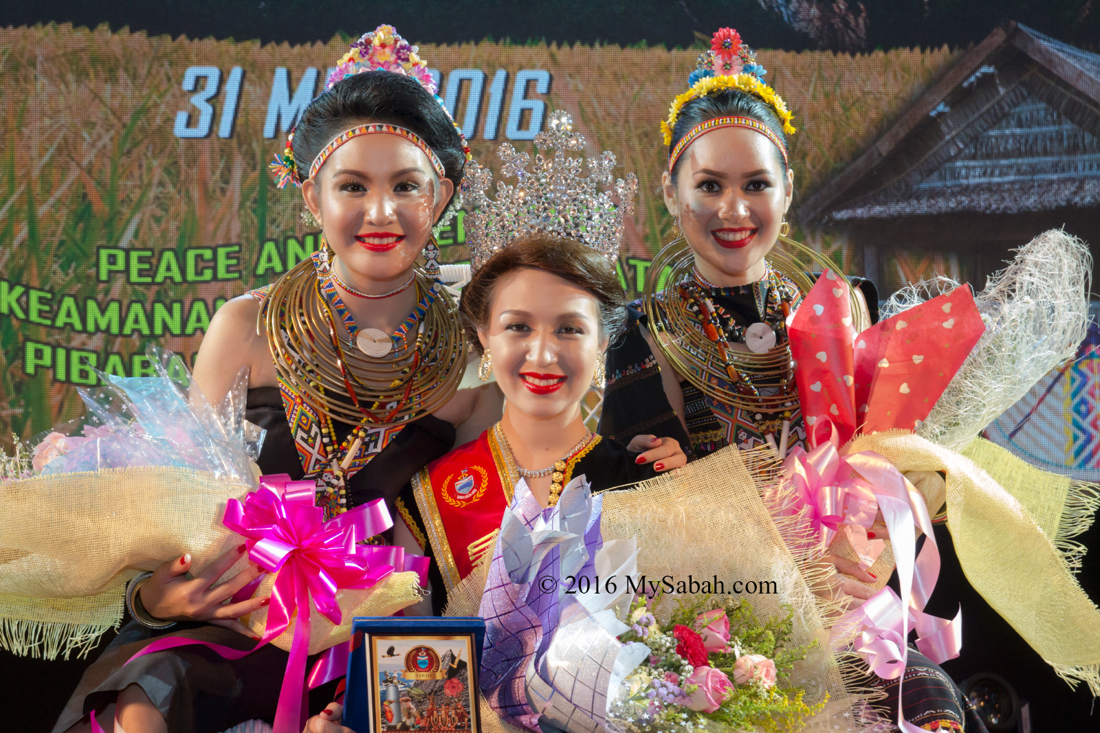 From left to right: 1st Runner-up: Claryssa Henry (Kudat), The Queen: Sherry Ann Laujang (Penampang), 2nd-Runner-up: Fenny Ester Joslin (Banggi)