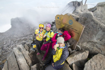 Happy lady climbers on the summit