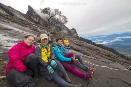 girls rest on slope