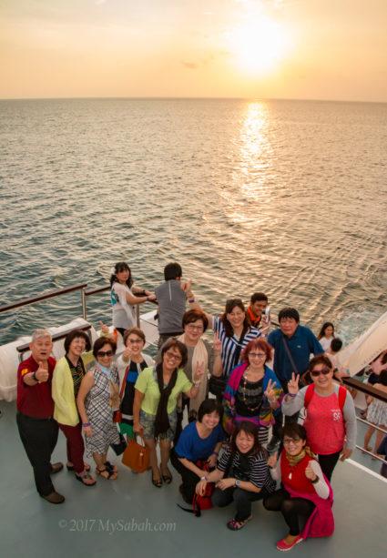 Tourists enjoying the sunset view