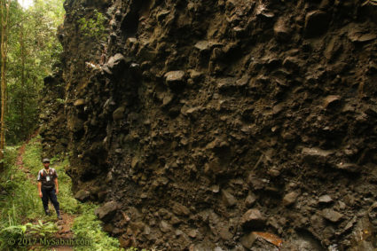 Dark rock wall before the Bat Cave