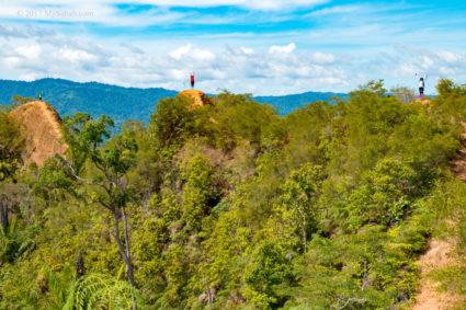 Climbers stood on three high points of Bukit Lugas