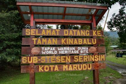 Signage at the entrance. Translation: Welcome to Kinabalu Park, Serinsim Sub-Station, Kota Marudu