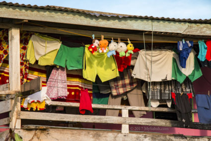A house with colorful hanging clothes in Malubang