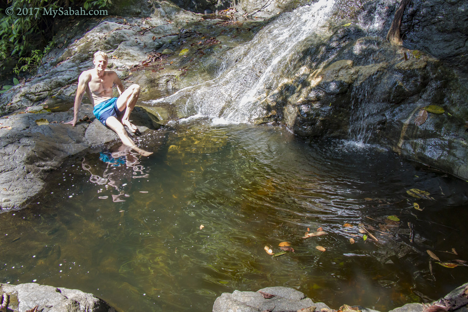 Swimming in the waterfall pond