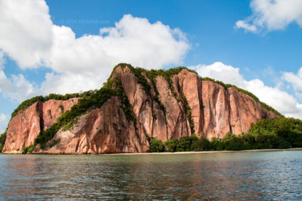Red cliff face of Berhala Island