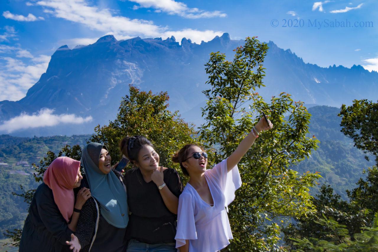 Girls selfie with Mount Kinabalu