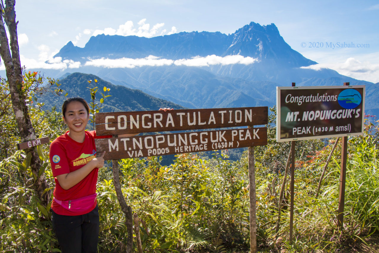 Photo next to summit signage of Mount Nopungguk