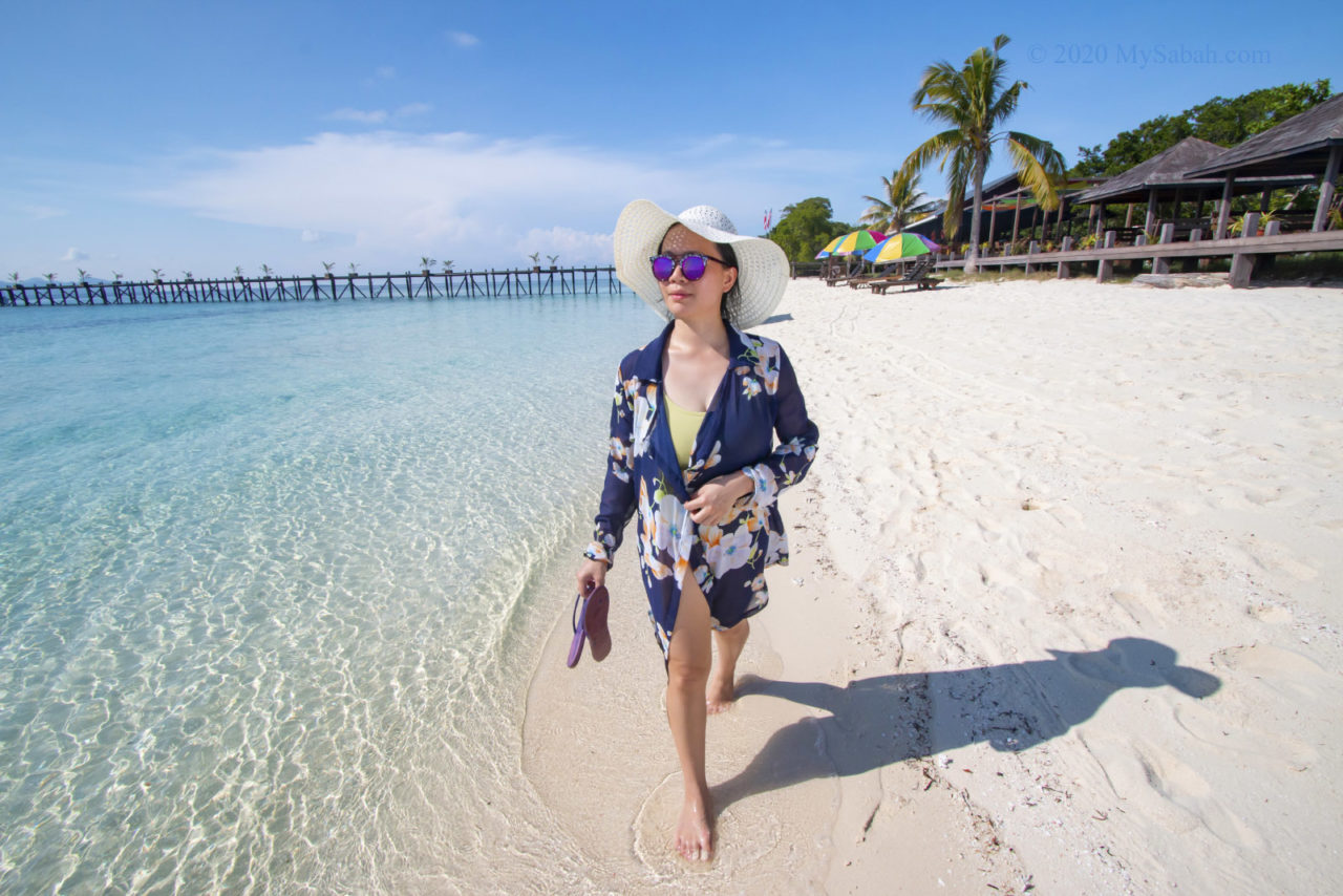 Lady walking on the beach of Pulau Timba-Timba